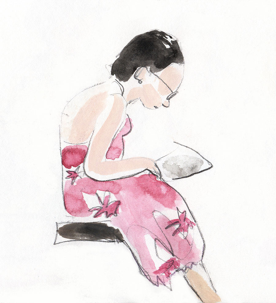 woman in wine coloured dress reading
